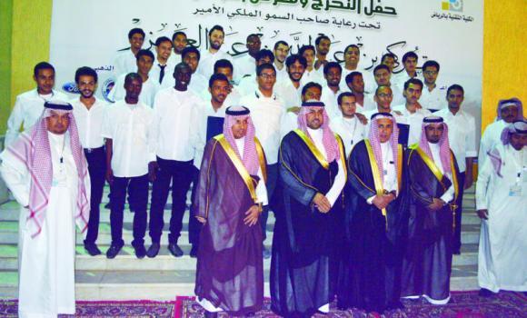 Riyadh Technical School graduates with Riyadh Gov. Prince Turki bin Abdullah bin Abdul Aziz at the graduation ceremony on Monday.