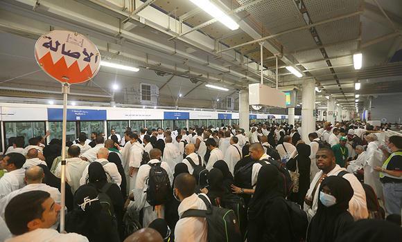 Haji in Mina Waiting for Train