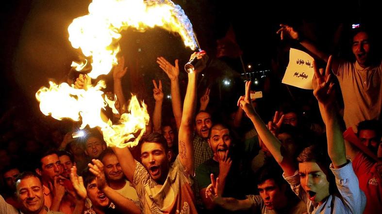 Iranians celebrate following a landmark nuclear deal in Tehran, Iran, Tuesday, July 14.