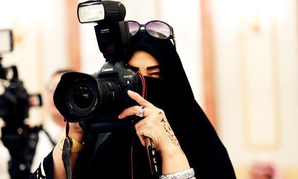 In this Nov. 10, 2015 photo, a journalist takes photos at a palace in Riyadh, Saudi Arabia.