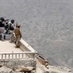 Saudi soldiers take their position at Saudi Arabia's border with Yemen.
